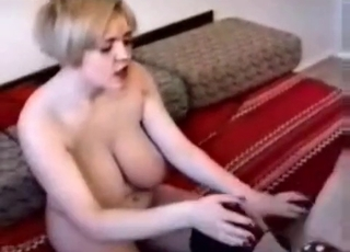 Busty blonde fucked by a doggy