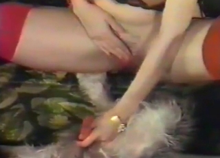 Sweet slut wanks a dog dick